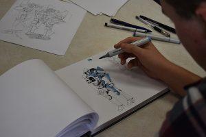 A closeup of Junior Zach Whistles artwork