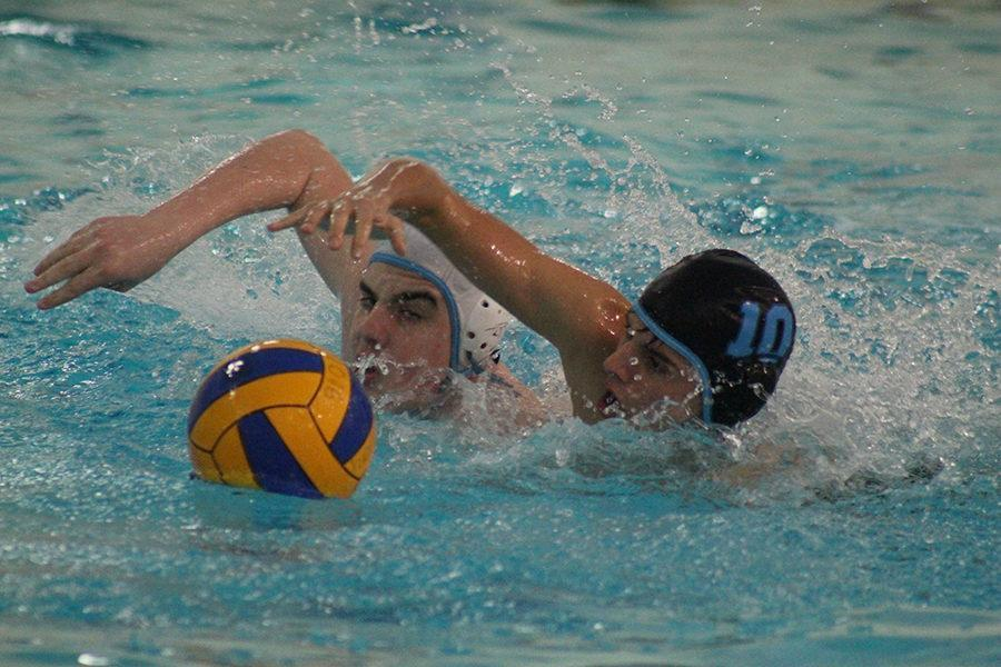 Sophomore+Paris+Wilken+and+freshman+Ryan+Mendonsa+swim+for+the+ball+as+part+of+their+preparation+during+water+polo+practice.