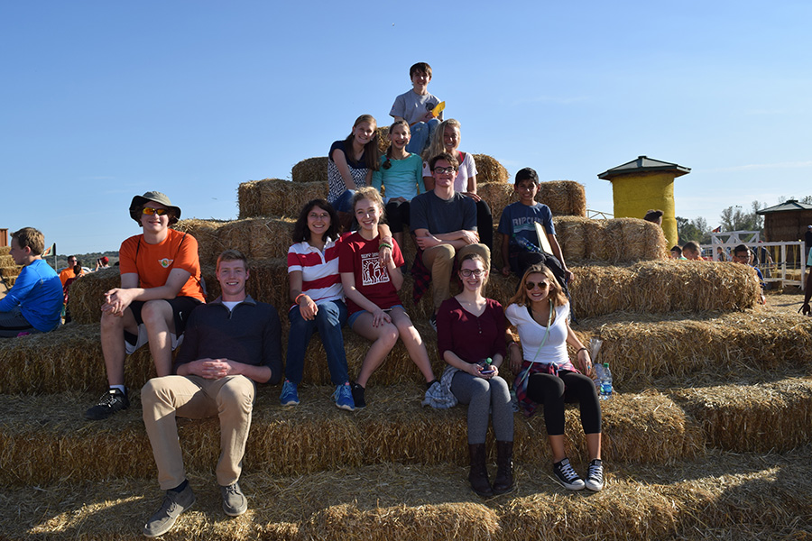 Sitting+on+hay+stacks%2C+the+Best+Buddies+club+poses+for+a+picture+at+Match+of+the+Patch.