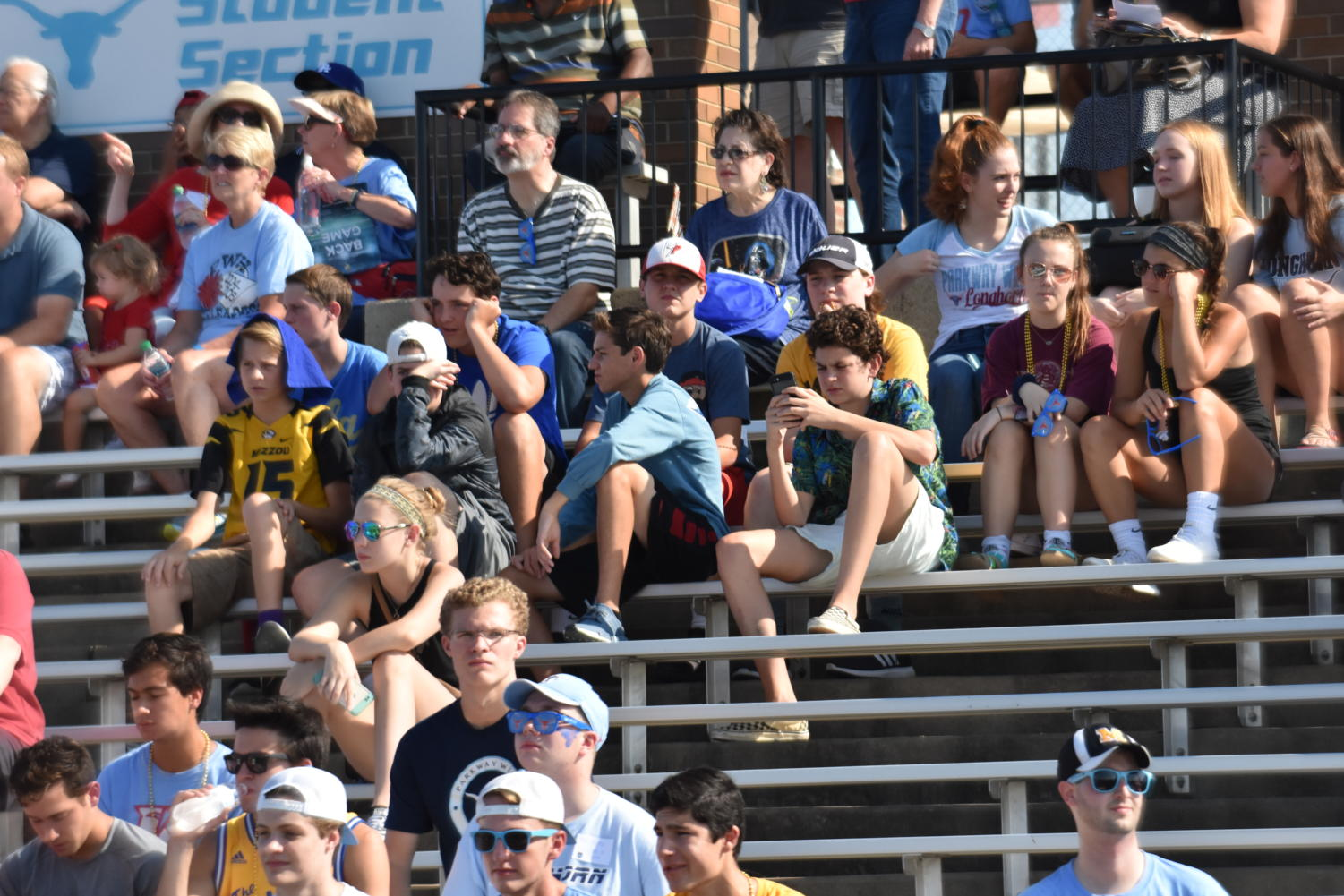 During the home football game against Ladue, the student section, which includes parents, is sparse.