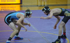 Six minutes on the mat: senior Josh McCallister looks towards state