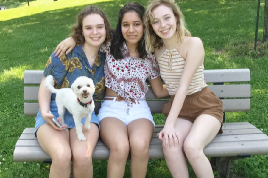 Enjoying+the+summer+day%2C+maltipoo+Ruby+smiles+with+juniors+Juliane+Pautrot%2C+Megan+Roberts+and+Kristin+Priest.+Roberts+made+an+Instagram+account+dedicated+to+posting+selfies+of+her+dog.+%E2%80%9CRuby%E2%80%99s+very+feisty+and+sassy%2C+she+has+such+an+attitude%2C%E2%80%9D+Roberts+said.+%E2%80%9CRuby+literally+thrives+off+of+socializing.%E2%80%9D