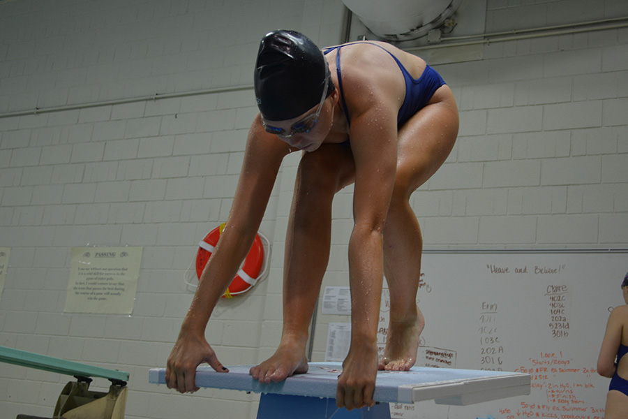 Senior Sophie Vietor practices her dive at swim practice. As a sprinter, the beginning of a race is important.