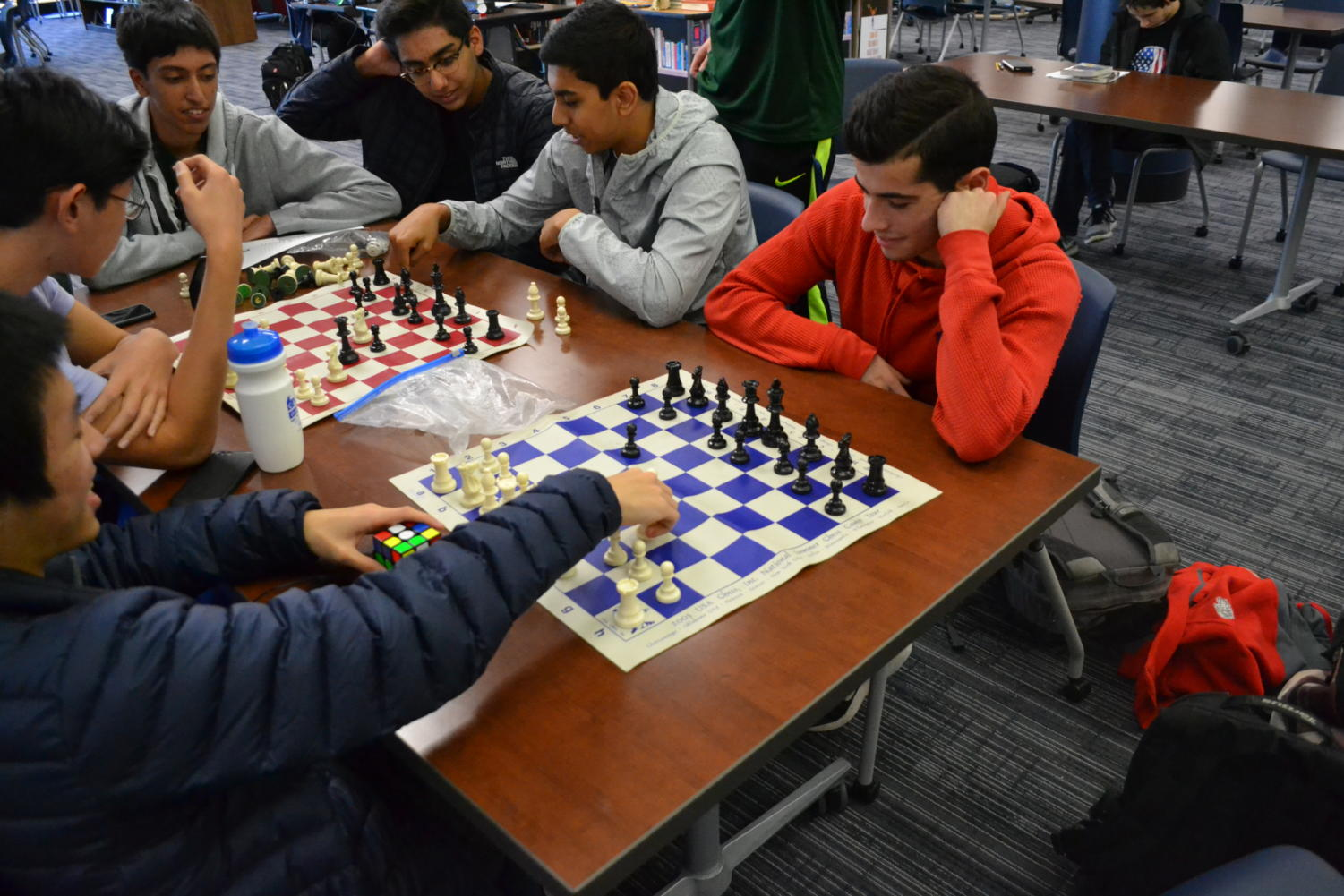 """Paul Gipkhin is planning his strategy of attack in a chess game against Jason Wan. Gipkhin memorized all his opening moves and plans to use his specialty. """"My favorite opening is the Sicilian Defense opening,"""" Gipkhin said. """"It is a powerful opening and it is my specialty. I still need to perfect it so I have to practice different variations."""""""