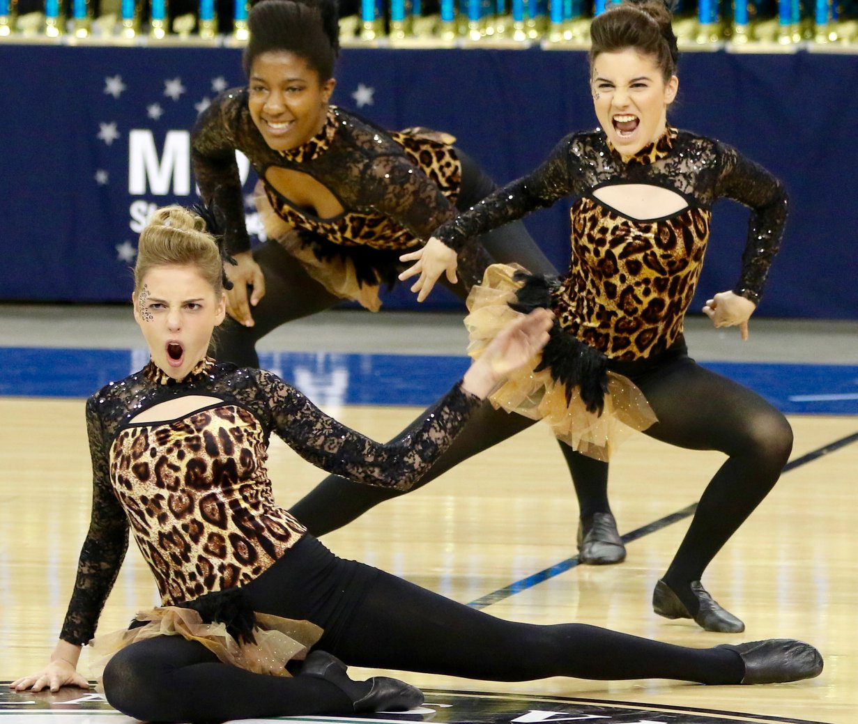 """Sophomores Susie Seidel and Sadie Hershenow perform with junior Kaleiya Andrews. The team honed their technical skills and stage presence. """"I've learned even the best dancers are going to make mistakes when they're performing, but as long as you keep smiling and having fun no one will even notice,"""" Seidel said."""