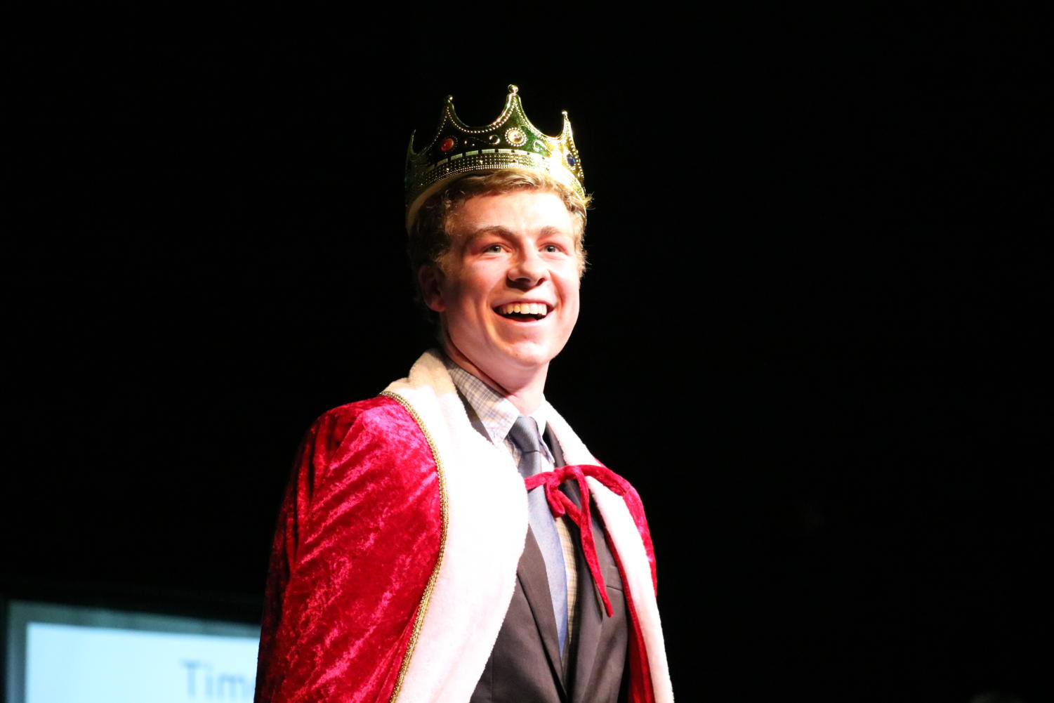 """Senior Lance Griffith grins at the packed auditorium after being crowned 'Mr. Longhorn.' For the 'talent' portion of the show, Griffith partnered with senior Chris Bass and reenacted the iconic lift scene from Dirty Dancing. """"It was extremely exciting and rewarding to see my hard work preparing for the event pay off, I wanted my performance to be really good and I'm happy people liked it,"""" Griffith said. """"Chris and I spent a lot of time working on the dance and had an amazing time performing it. All the moves went right and the crowd got really into it, it was quite a unique experience."""""""