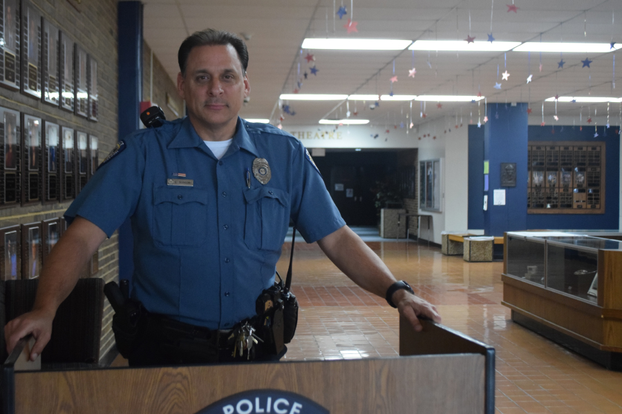 Standing at the building entrance, school resource officer Scott Scoggins works with local police and Parkway officials to keep the school safe. Scoggins worked with the district and administration to be sure that our school was safe today.