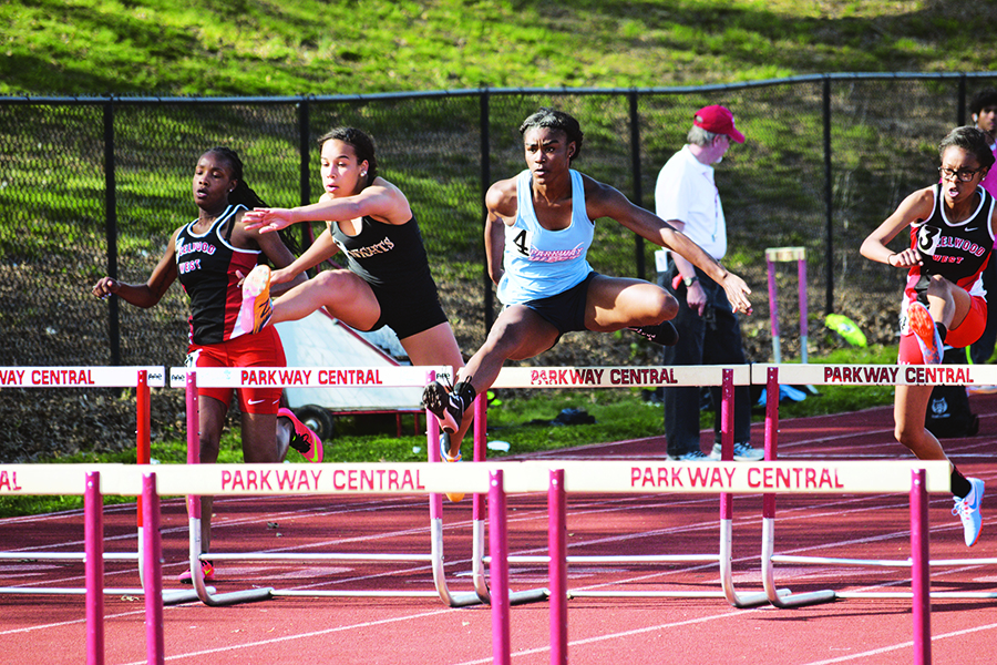 """Clearing the hurdle, Williams-Harkins competes in a meet at Parkway Central. Williams-Harkins raced the 100 meter hurdles.""""When the gun goes off, it is complete silence. I can't hear anything. It is just a straight shot,"""" Williams-Harkins said."""
