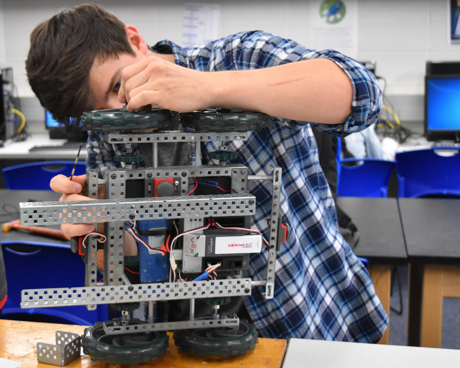 "Senior Scott Hardy makes adjustments to his robot. Prior to their confrontation at state, the team was meeting up after school everyday. ""It's a tad disappointing that we didn't get first,"" Hardy said. ""But considering the degree to what that we worked with and considering we went as far in the first place, I'm actually proud of myself [and] the team, especially some people on there and really how much work we put into it."""