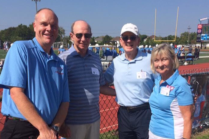 """Bill Byrd (center left) stands with current principal Jeremy Mitchell, and former principals Dave McMillan and Beth Plunkett at West's 50th anniversary football game and celebration. Byrd had continued to stay connected to the West community even after leaving his post as principal in 1987 through his three children's enrollment and attendance to football and basketball games. """"We currently have a granddaughter [sophomore Susie Seidel] at West and enjoy attending her activities and listening to her West stories.  I feel very honored and fortunate to have been a part of West High for the past 50 years,"""" Byrd said."""