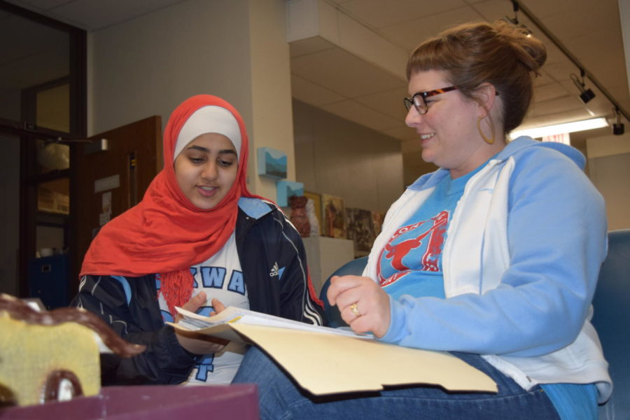 """Sophomore Namah Al Battah and art teacher Ashley Drissel look over meeting plans for the club We Dine Together. The club was created to ensure all students feel included in places like the cafeteria or classroom. """"We're trying to create a network of support,"""" Drissel said. """"[We want] to have a culture here at West High that is supportive and inclusive instead of exclusive."""""""