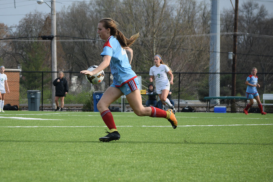 """Freshman Leah Selm settles the ball against Nerinx Hall April 13. Nerinx defeated West 0-2. """"It was a good game. I thought our team played really well and put up a good fight,"""" Selm said."""