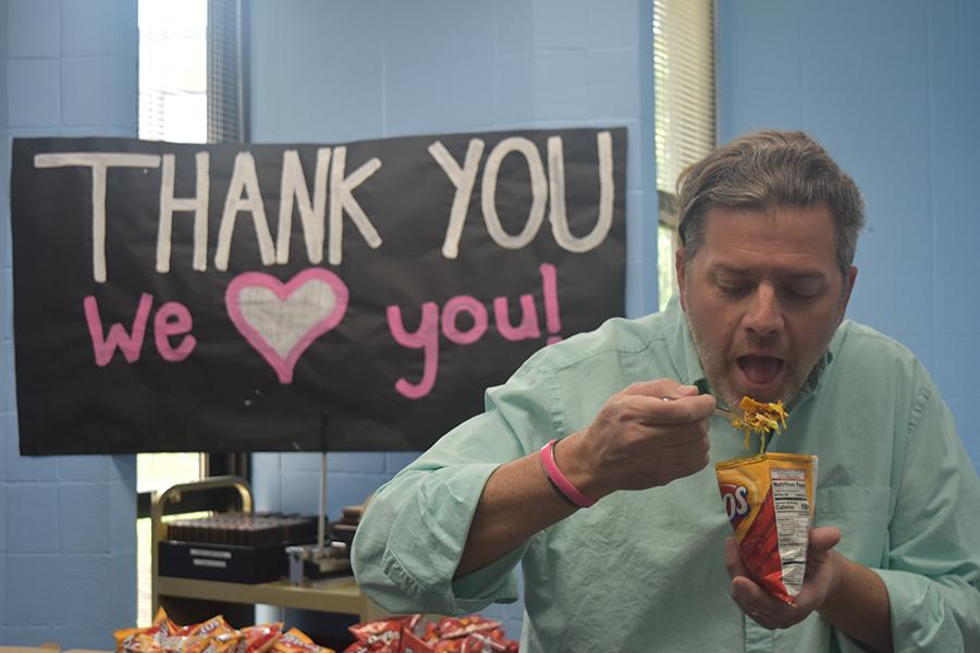 Social studies teacher Mel Trotier enjoys walking taco at the Friday, May 11 teacher appreciation taco bar.