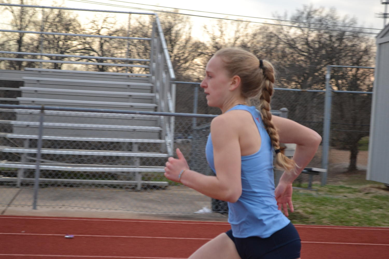 "Tess Allgeyer runs down the track as she gets back into the program. Fighting through her injury, Allgeyer hopes to return. ""I should be able to come back and compete with the team, and I will be able to run track next year,"" Allgeyer said."